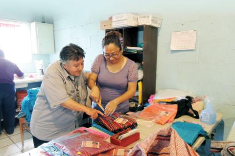 Maryknoll Sister Margaret Sierra, left, with member of a sewing cooperative in Juarez, Mexico, 2018.